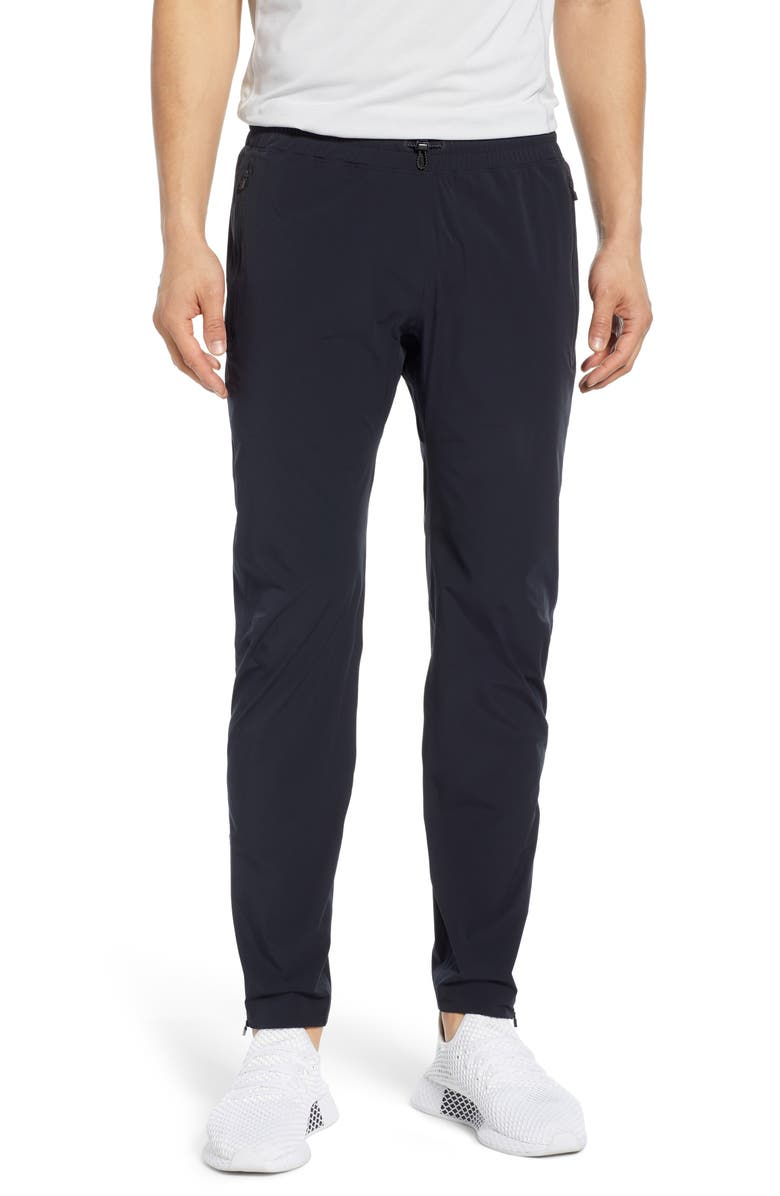 REIGNING CHAMP Team Water Repellent Track Pants, Main, color, 001