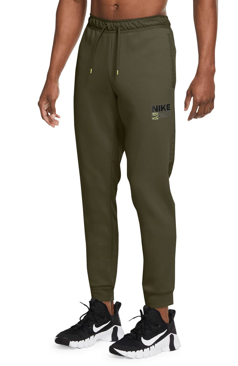 NIKE Dri-FIT Tapered Pocket Training Pants, Main, color, ROUGH GREEN/ ROUGH GREEN