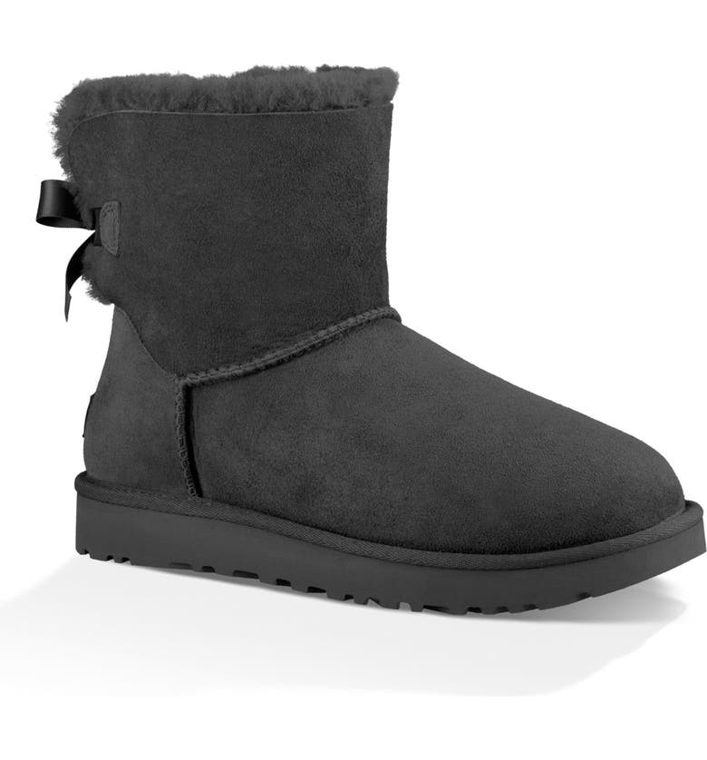 UGG<SUP>®</SUP> Mini Bailey Bow II Genuine Shearling Bootie, Main, color, BLACK SUEDE